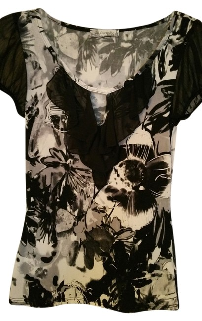 On Carnaby Stretchy Material Or Work Appropriate Floral Pattern Top Black and white w/ruffle,cut out neck and sheer sleeves
