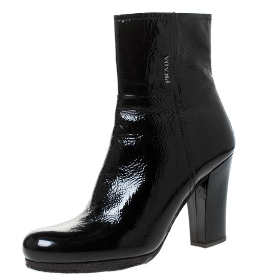 Preload https://img-static.tradesy.com/item/27585290/prada-black-patent-leather-ankle-length-bootsbooties-size-us-105-regular-m-b-0-0-540-540.jpg