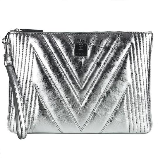 Preload https://img-static.tradesy.com/item/27585455/mcm-new-quilted-metallic-medium-wristlet-pouch-silver-leather-clutch-0-0-540-540.jpg
