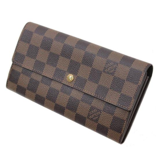 Preload https://img-static.tradesy.com/item/27586029/louis-vuitton-brown-damier-canvas-ebene-ebene-portofeuille-sala-old-model-n61734-ca0193-wallet-0-0-540-540.jpg