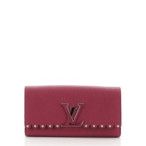 Louis Vuitton Capucines Leather Wristlet in Pink