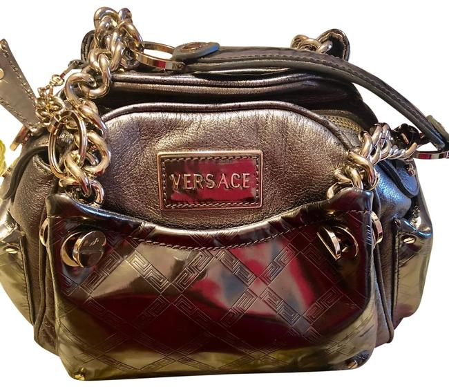 Item - 2-tone Colors. Purse Much Lighter In Color Than Pictures Immaculate Inside. Platinum Silver Smooth Soft Leather with Vinyl Covered Leather Front Back and Side Pockets. 2 8.5 Leather and Chain Handles. Satchel