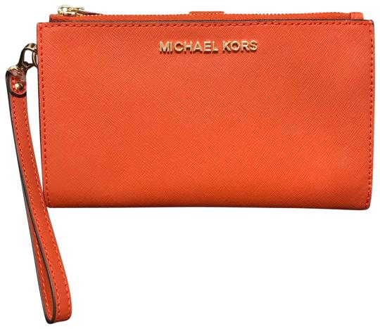 Preload https://img-static.tradesy.com/item/27601407/michael-kors-orange-leather-lg-double-zip-wristlet-wallet-0-1-540-540.jpg