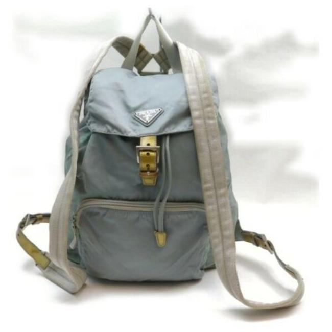 Item - Angular Nylon/Leather Multi-compartment Drawstring Top Light Blue/Gold/White Nylon and Leather Backpack
