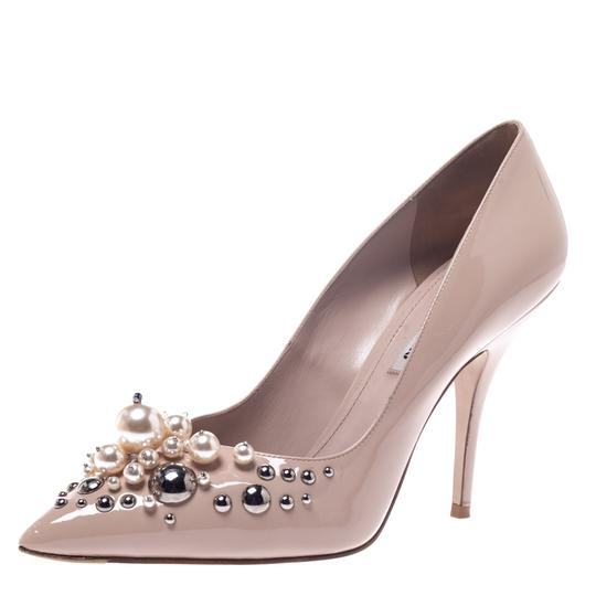 Preload https://img-static.tradesy.com/item/27670329/miu-miu-beige-black-patent-leather-pearl-embellished-pointed-pumps-size-us-75-regular-m-b-0-0-540-540.jpg