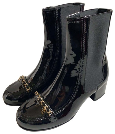 Preload https://img-static.tradesy.com/item/27687091/chanel-black-chelsea-bootsbooties-size-eu-375-approx-us-75-narrow-aa-n-0-1-540-540.jpg