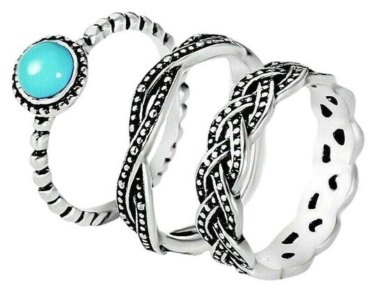 Preload https://img-static.tradesy.com/item/27687118/unbranded-silver-and-turquoise-bohoemian-vintage-stacking-band-set-three-piece-ring-0-1-540-540.jpg