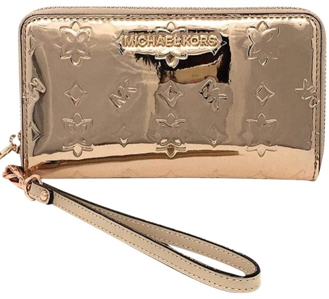 """Item - Bill Compartment. 5 Credit Card Slot. Size 7"""" X 4"""" H X 1"""" D. Iphone 5 & 6 Compatible. Zip Coin Compartment. I. D. Gold Or Rosegold Wristlet"""