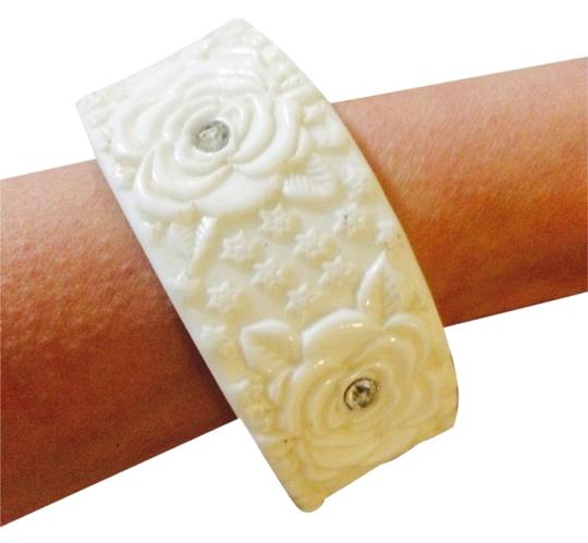 Preload https://item1.tradesy.com/images/other-plastic-white-bracelet-with-acrylic-roses-and-gems-2779975-0-1.jpg?width=440&height=440
