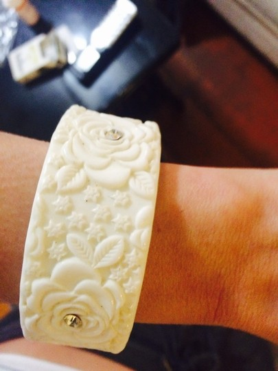 Other plastic white bracelet with acrylic roses and gems