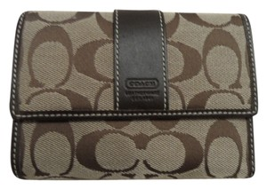 Coach Coach Bi-fold Wallet in tan and brown, large C jacquard with dark leather trim
