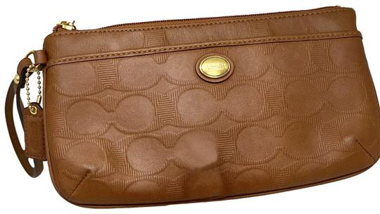 Preload https://img-static.tradesy.com/item/27870874/coach-brown-leather-wristlet-0-1-540-540.jpg