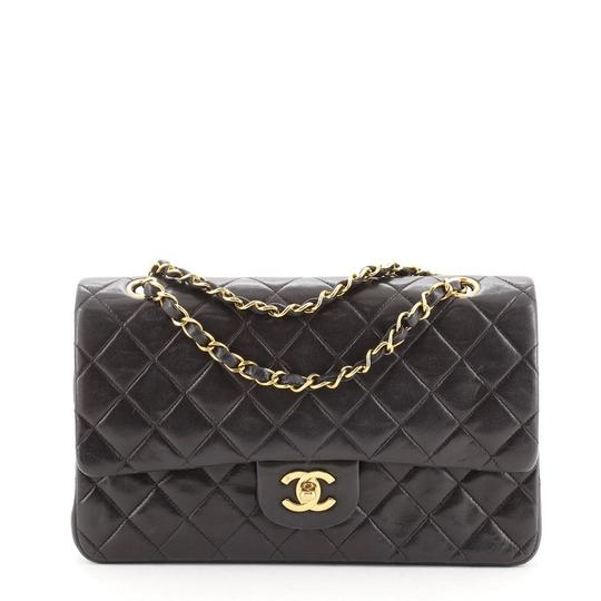 Preload https://img-static.tradesy.com/item/27973886/chanel-classic-flap-vintage-classic-double-quilted-lambskin-medium-black-leather-shoulder-bag-0-0-540-540.jpg