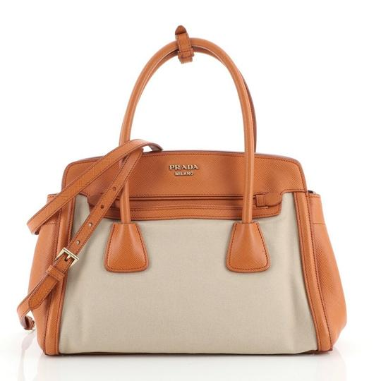 Preload https://img-static.tradesy.com/item/27991648/prada-cuir-frame-convertible-canvas-and-saffiano-small-neutral-orange-leather-tote-0-0-540-540.jpg