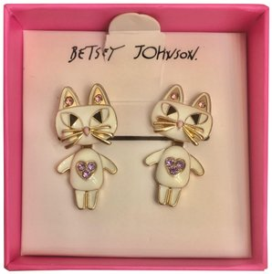 Betsey Johnson FREE with $125 purchase.