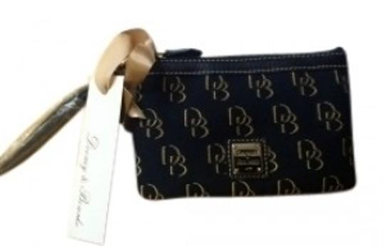 Preload https://img-static.tradesy.com/item/28049/dooney-and-bourke-fabric-black-and-brown-wristlet-0-0-540-540.jpg
