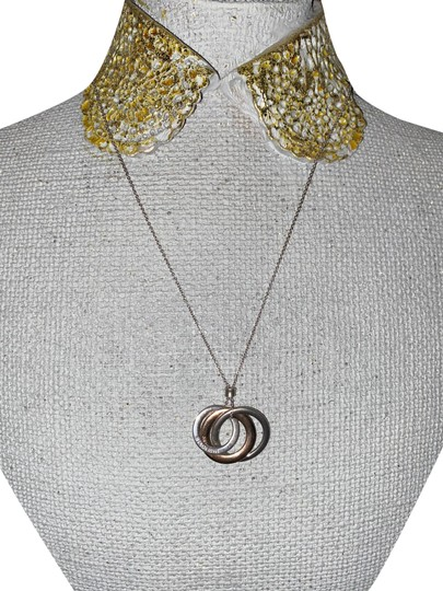 Preload https://img-static.tradesy.com/item/28056287/tiffany-and-co-sterling-silver-and-rubedo-1837-interlocking-circles-pendant-necklace-0-1-540-540.jpg