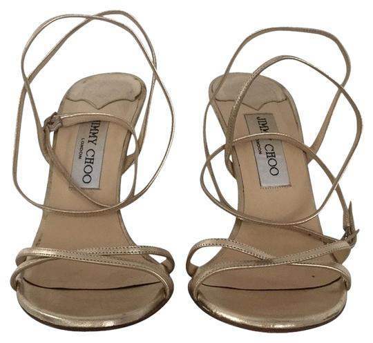 Preload https://item1.tradesy.com/images/jimmy-choo-gold-sandals-size-us-105-regular-m-b-2806075-0-0.jpg?width=440&height=440