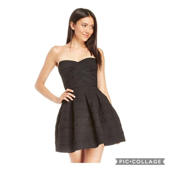 Item - Black Strapless Fit and Flare Bandage Mid-length Cocktail Dress Size 6 (S)