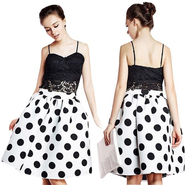 Preload https://item4.tradesy.com/images/b-and-w-trendy-polka-dot-pleated-midi-size-2-xs-26-2827423-0-0.jpg?width=400&height=650