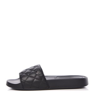 Item - Black Lambskin Quilted Cc Mules Sandals Flats