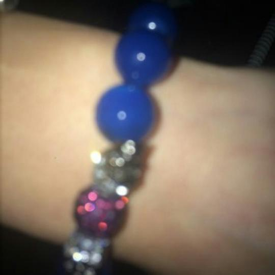 Electric Picks skull crystals with a purple ball bracelet