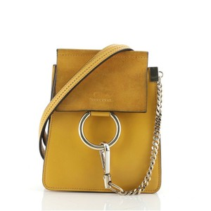 Item - Faye Bracelet and Suede Mini Yellow Leather Cross Body Bag
