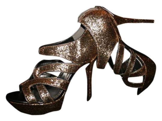 Preload https://item5.tradesy.com/images/bebe-gold-sparkle-sexy-strappy-platforms-size-us-9-284934-0-0.jpg?width=440&height=440