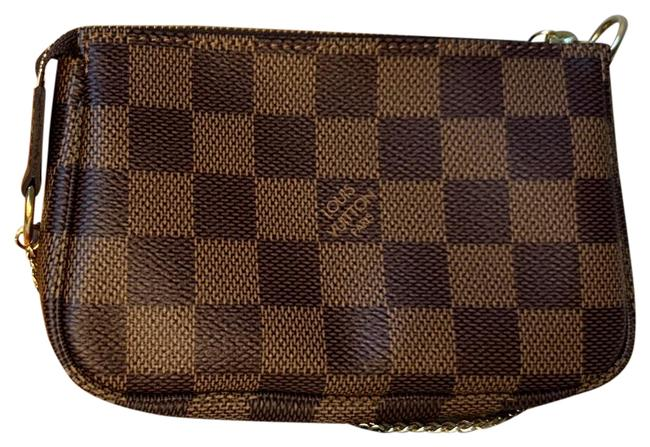 Item - Pochette Accessoires Mini Damier Eben Print with Brown Vechetta and Gold Hardware. The Interior Is Red. Coated Canvas Wristlet