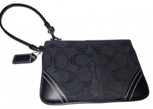 Preload https://item2.tradesy.com/images/coach-black-signature-wristlet-wallet-28586-0-0.jpg?width=440&height=440