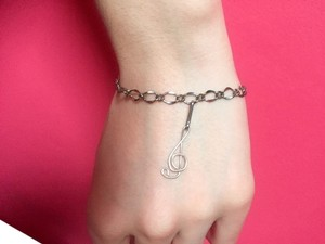 Avon Silver Colored Bracelet with Music Note Charm