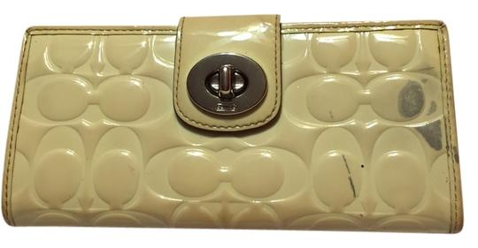 Preload https://item1.tradesy.com/images/coach-peyton-embossed-ret500-wallet-only-yellowish-white-patent-leather-clutch-2870920-0-1.jpg?width=440&height=440