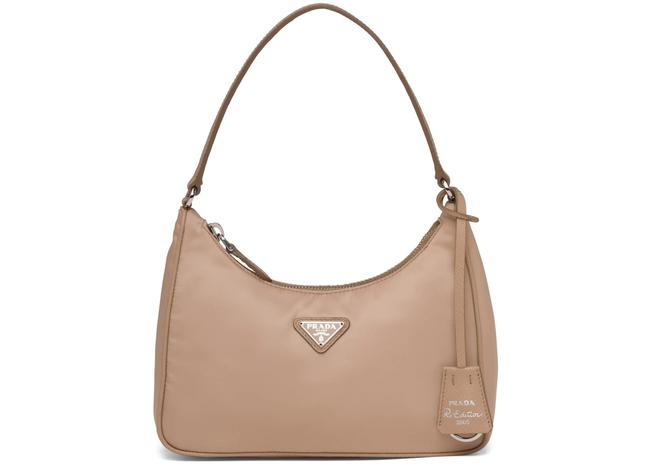 Item - Re-edition 2000 Cameo Beige The Nylon Mini Is Decorated with Iconic Saffiano Leather Trim. It Features A Contemporary Mix Of Materials. Shoulder Bag