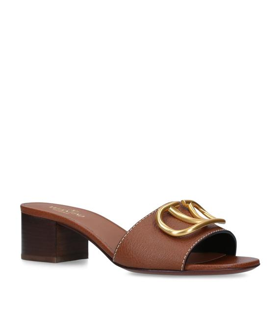 Item - Tan Garavani Leather Vintage V Mules/Slides Size EU 39.5 (Approx. US 9.5) Regular (M, B)