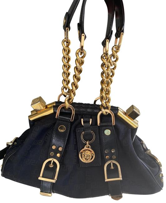 Item - Basements. Black Limited Edition Clasp Purse. Canvas with Monogram with Leather Trim and Gold Embellishments. Satchel