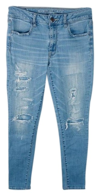 Item - Blue Light Wash Super Stretch Faux Patches Destroyed Jeggings Size 29 (6, M)