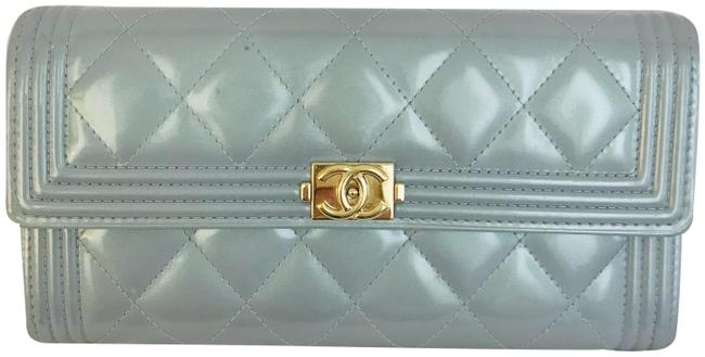 Item - Blue Boy Pearlized Patent Quilted Flap Wallet