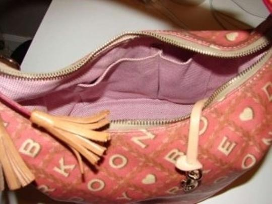 Dooney & Bourke Tote in pinkish rose with cream lettering