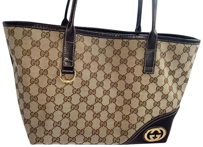 Item - Britt Tan Brown and Some Gold Canvas W Leather Trim Inner Fabric Hardware Tote