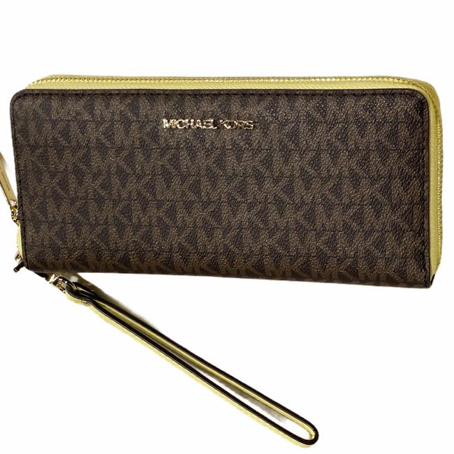 Item - Jet Set Large Continental Wallet Mk Buttercup Yellow Brown Leather Wristlet
