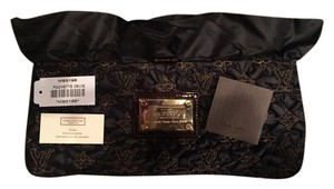 Louis Vuitton Black And Gold Clutch