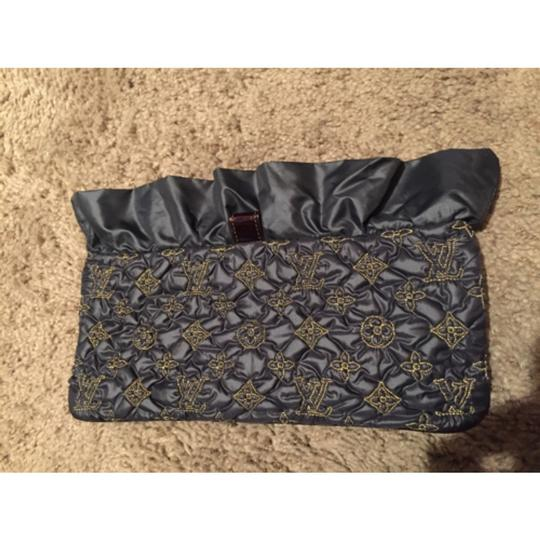 Louis Vuitton Black And Gold Clutch Image 2