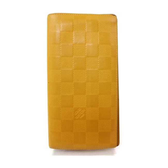 Item - Yellow Long Damier Infini Leather Portefeuille Brazza 863382 Wallet