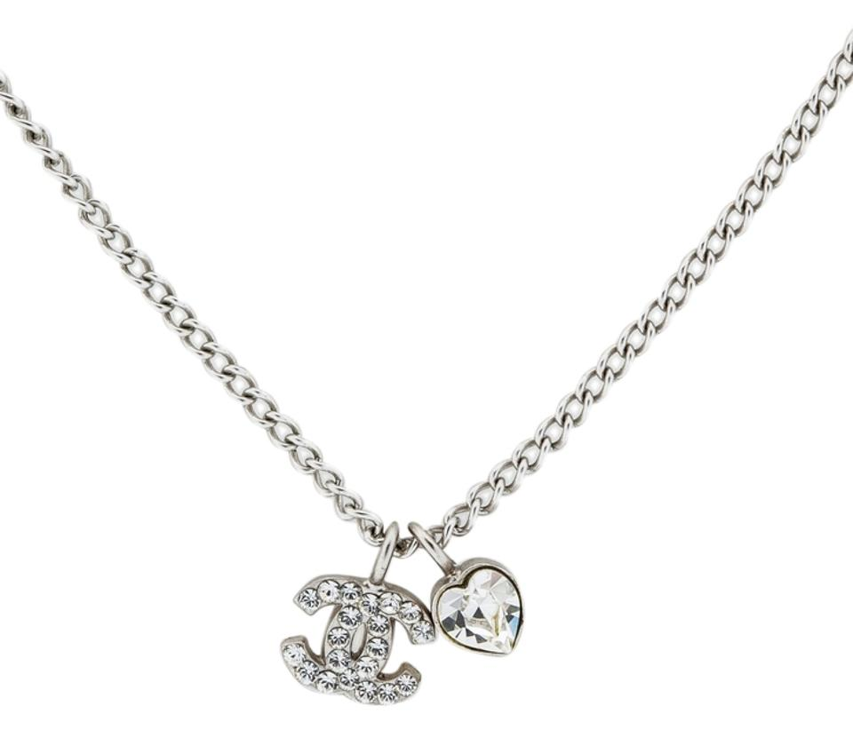 Chanel silver crystal cc logo heart pendant tone hardware swarovski chanel chanel crystal cc logo heart necklace pendant silver tone hardware swarovski mini classic timeless aloadofball Image collections