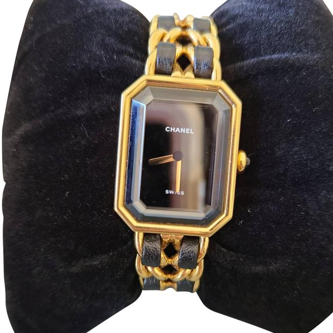 Item - Black and Gold Swiss Watch