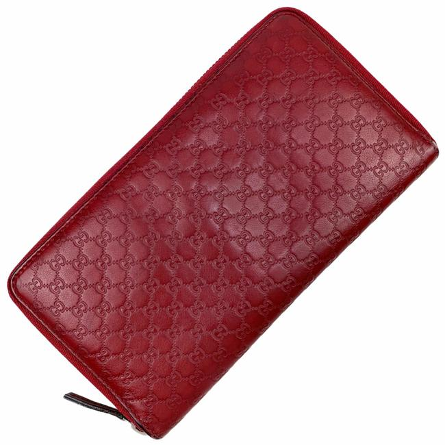 Item - Red Microguccissima Leather Zip Wallet