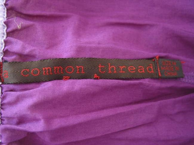 A Common Thread short dress 100 % silk Yellow and purple on Tradesy