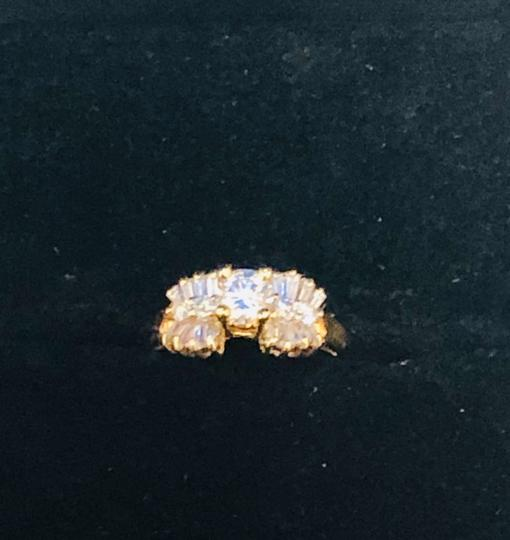 Yellow Gold Round and Baguette Diamond In 14k 1.30 Tcw Engagement Ring Image 5