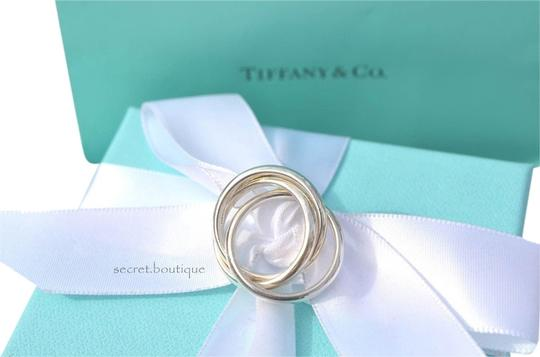 Preload https://item4.tradesy.com/images/tiffany-and-co-sterling-silver-three-rolling-size-5-ring-2945533-0-0.jpg?width=440&height=440