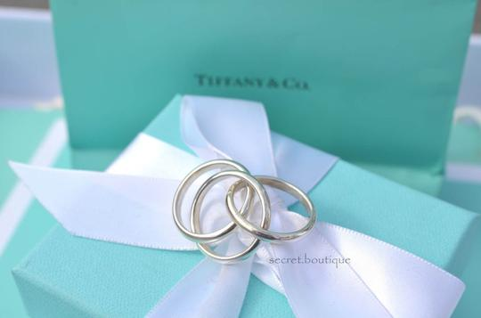 Tiffany & Co. TIFFANY & CO. STERLING SILVER THREE ROLLING RINGS size 5